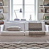 Pictured:  Bemz cover for Karlstad 3 seater sofa loose fit urban in absolute white rosendal pure washed linen Bemz cushion cover in noir brera fino designed by Designers Guild