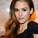 Need to update your long hair? Just flip it over to one side like Jessica Alba. Whether you wear your hair straight, tousled, or curly, you'll find that it's a fast way to add a touch of sexiness to your style.