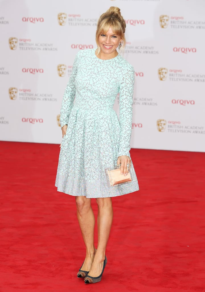 Sienna Miller was most recently spotted in an innocent-looking light blue Matthew Williamson creation at the 2013 British Academy Television Awards. But upon closer review, her clear Charlotte Olympia clutch and studded Christian Louboutin pumps provided a layer of cool-girl edge to an otherwise girlie look.