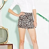 If too much leopard is, well, too much, then this ensemble might work better for you because the white blouse helps break up the print.