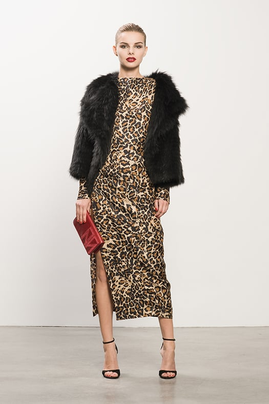 Coyote Black Fur Jacket, Jacquard Leopard Dress, Whisper Black Suede Sandal, TM Enjoy Red Clutch. Photo courtesy of Tamara Mellon