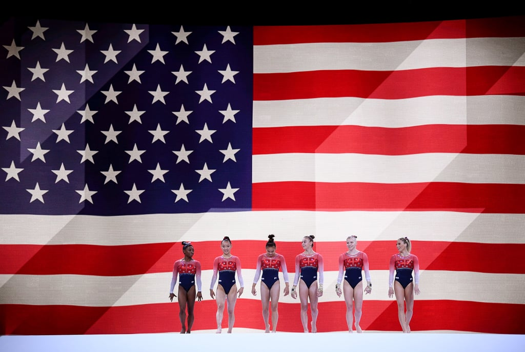 """The US women's gymnastics team finished first in the qualifying round of the 2019 World Artistic Gymnastics Championships in Stuttgart, Germany, by five whole points — and in the team final on Oct. 8, they did it again, winning by nearly six points. They scored a 172.330 in front of Russia (166.529) and Italy (164.796). This is their record-tying fifth consecutive World team title, and it's also their seventh win of all time. According to NBC Sports, the US has won every Olympic and World Championship team competition since 2011. At Worlds, three gymnasts compete on every event, and all three scores count. Five-time Olympic medalist and four-time World all-around champion (going for her fifth win on Thursday) Simone Biles competed in all four events, 2018 Worlds team gold medalist and 2019 Nationals bronze medalist Grace McCallum was up on vault and bars, 2019 Nationals floor and vault silver medalist Jade Carey was up on those two events, 2019 Nationals silver medalist Sunisa Lee competed on bars, beam, and floor, and 2018 Worlds team gold medalist Kara Eaker was up on beam. MyKayla Skinner, alternate at the 2016 Olympics and University of Utah collegiate gymnast, was the team's alternate here. The US started strong on vault and led the competition from the first rotation by about a point and a half. Simone did not do her now-name-bearing double-double dismount off beam that she competed during the qualifying round on Oct. 5, but she did do her high-flying triple-double on floor, now called """"The Biles II"""" (she landed it with a huge smile before soaring through the rest of a solid routine). Despite a mistake from Grace on bars, the US women were able to hang on during the second rotation and increase their lead to almost four points. They then stayed on top every rotation thereafter even with Sunisa's fall on beam. In the end, they won by almost six points. Simone Biles won her 21st World Championship medal — her 15th gold — and is en route to tying or beating Belar"""
