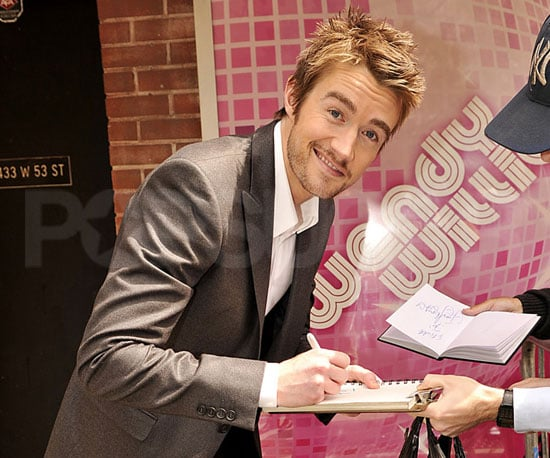 Slide Picture of Robert Buckley Signing Autographs For Fans