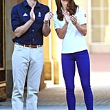 Prince William and Kate clapped as they greeted the Olympic torch.