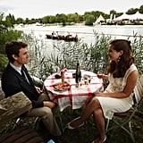 A couple enjoy Champagne and smoked salmon alongside the River Thames.