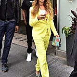 Beyonce is wearing the Zadig & Voltare Ved Deluxe Blazer ($550) and Parone Deluxe Pant ($290), which she paired with a yellow bra and some striped heels.