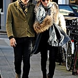 Kate Moss wore black boots for an outing with husband Jamie Hince in London.