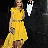 We couldn't resist one more photo of Olivia Palermo in gorgeous yellow Katie Ermilio, alongside her boyfriend, Johannes Huebl, at the 10th annual New Yorkers For Children Spring dinner.