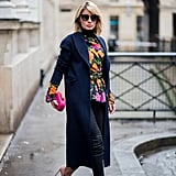 With a Floral Patterned Top, a Long Navy Coat, and Leather Pumps