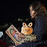 """Her cuffs stole the spotlight while she read """"'Twas the Night Before Christmas"""" during the ceremony."""
