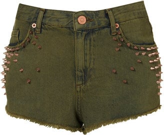 Instead of the usual pair of denim shorts, we suggest you switch things up and try out this studded army-green pair.  Topshop Army Green Studded Shorts ($70)