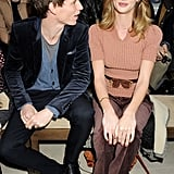 Eddie Redmayne chats with Rosie Huntington-Whiteley at the showing of Burberry's Fall 2012 collection.