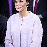 She Accessorized With Jade and Pink Gemstone Drop Earrings