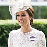 The year before, Kate wore an eerily similar white lace look by Dolce & Gabbana, and once again had her badge pinned to her chest.