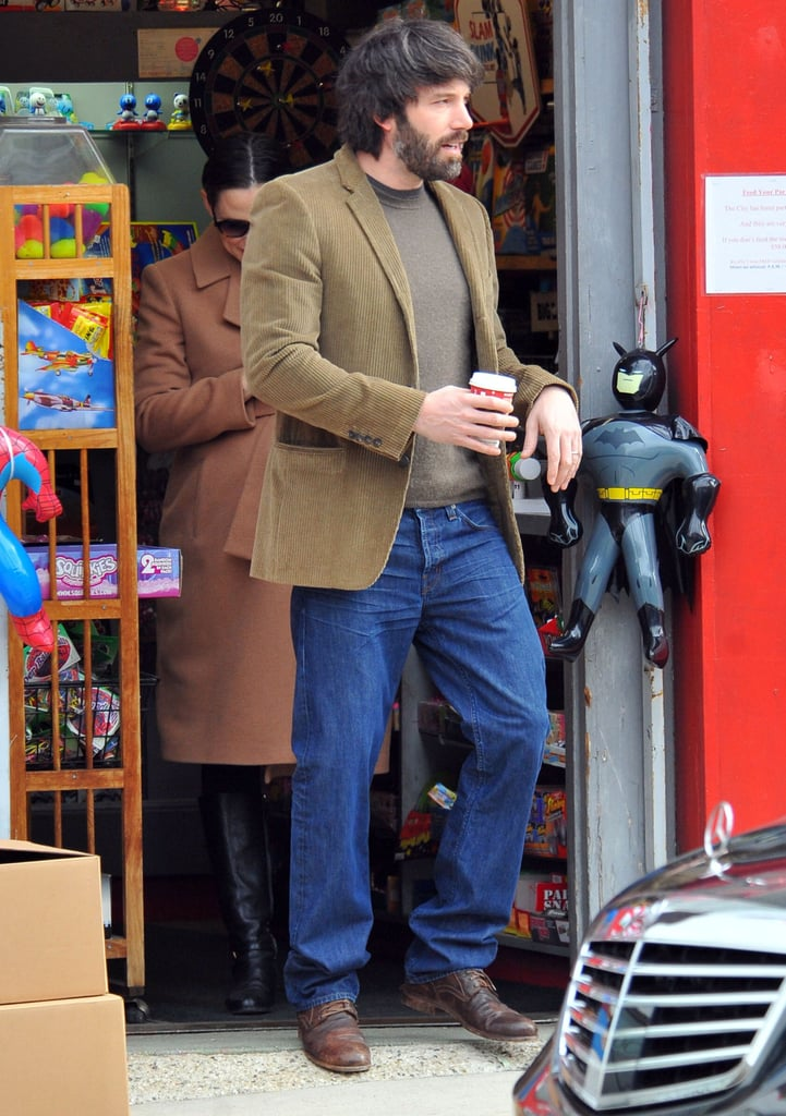 Ben carried a cup of coffee.