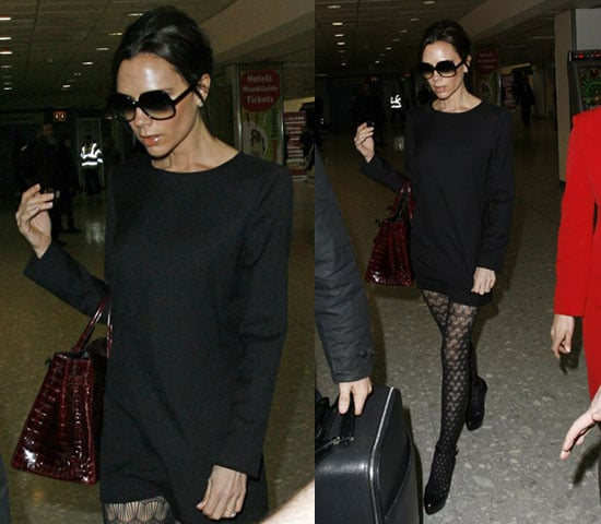 Victoria Beckham at Airport Wearing Black Sweater Dress, Patterned Tights, and Red Crocodile Bag