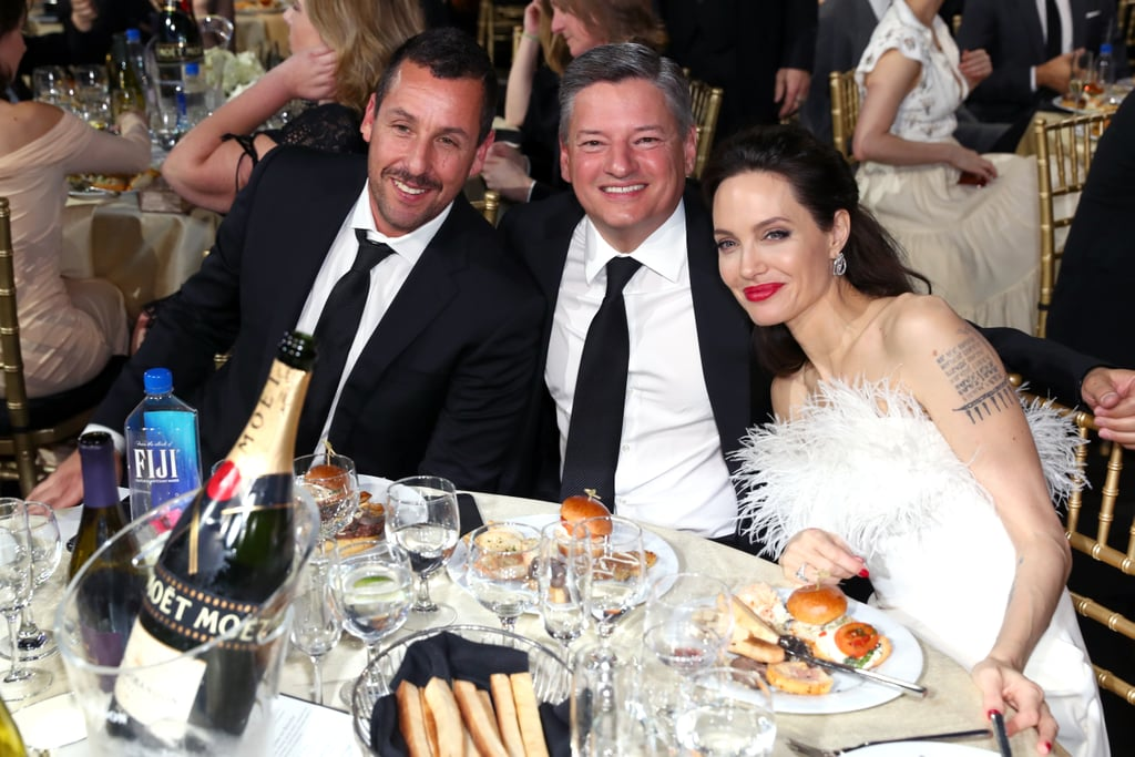 Pictured: Adam Sandler, Ted Sarandos, and Angelina Jolie