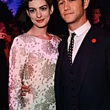 Costars Anne Hathaway and Joseph Gordon-Levitt smiled together.