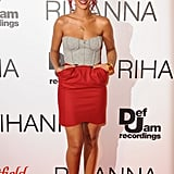 Rihanna looked radiant coordinating her fiery locks with a red pocketed mini-skirt and gray bustier in London in 2011.