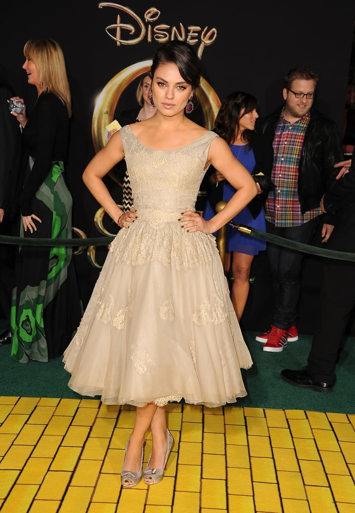 Mila Kunis took the fit-and-flare approach in a beige Dolce & Gabbana dress at the Oz the Great and Powerful premiere in LA.