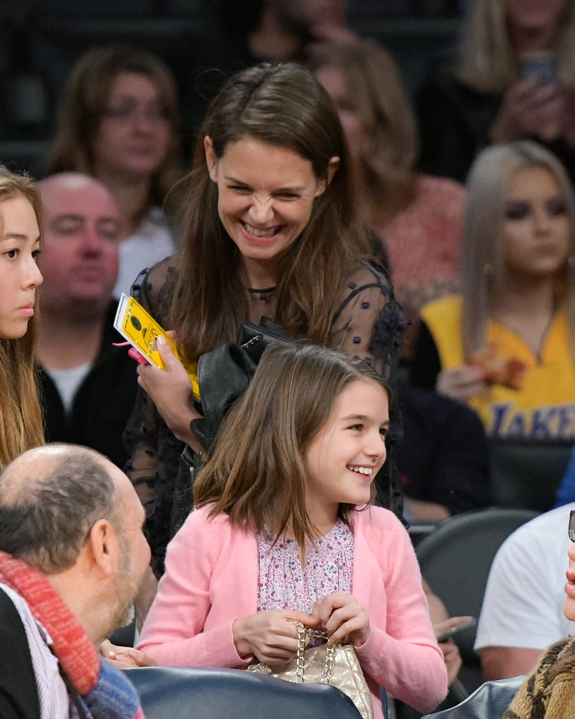 Suri Cruise looks more and more like mom Katie Holmes by the day. A few weeks after celebrating Katie's 38th birthday, the adorable pair hit the Staples Center in LA on Sunday with some friends to watch the Lakers take on the Detroit Pistons. Although Katie keeps her life with Suri rather private, she and her 10-year-old daughter never miss a big game. They notably attended a few of the March Madness games last year, where they watched the Notre Dame Fighting Irish take on the Stephen F. Austin Lumberjacks. Despite the Lakers' loss on Sunday, Suri and Katie were all smiles while sitting in the stands and chatting with fellow fans, proving once again that they're one of Hollywood's cutest mother-daughter duos.