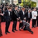 Then Taron Kindly Volunteers to Tie Elton's Shoe