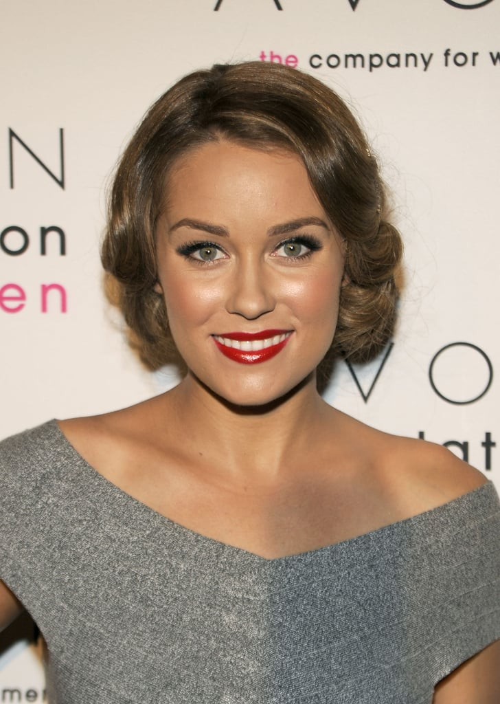 Lauren Conrad's hair had a '30s feel that can be re-created by curling the hair into the face with a wide barrel tong before you pin the ends up and under. Let the curls guide where you clip the hair up; it should help to make it look natural.