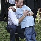Harry hugged a child at a Charities Showcase event in Antigua in 2016.