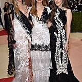 HAIM coordinated their black and white ensembles at the Met Gala in 2016.