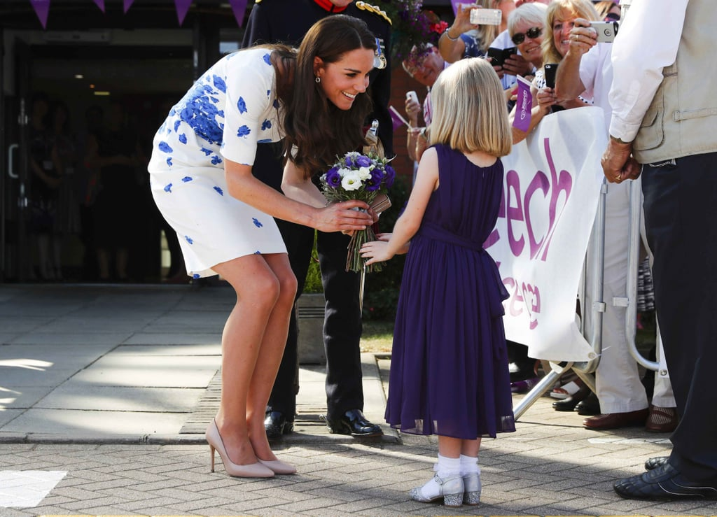 Kate accepted flowers from a little girl at London's Keech Hospire Care facility in August 2016.