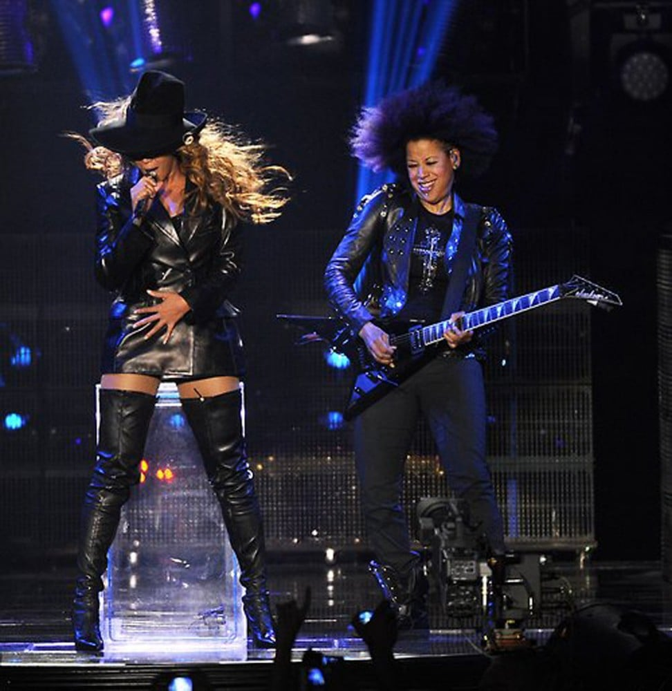 Beyoncé rocked it out in a black leather Emilio Pucci ensemble, including a double-breasted blazer dress and thigh-high boots.