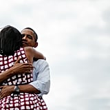 The Obamas hugged in Dubuque Iowa on August 15, 2012.