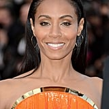 Jada Pinkett Smith lit up the carpet in hot orange.