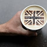 A man held a cappuccino topped with a Union Jack design in cocoa powder.