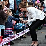 Kate knelt down to accept a daisy from a little girl during their royal tour of Canada in October 2016.