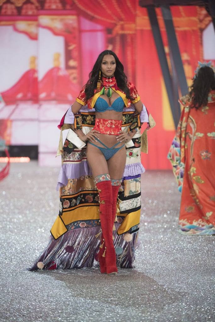 """In her second Victoria's Secret Fashion Show since earning her Angel wings in 2015, Lais Ribeiro looked beyond incredible.  The 26-year-old Brazilian model, who shared Instagram snippets of her time in Paris leading up to the show, stunned in pieces that flattered her slender figure on the runway, including one seriously colorful number and a black tree-inspired look, leaving us breathless. POPSUGAR caught up with Lais at the Fifth Avenue VS store a few days before the show's Dec. 5 air date, where she opened up about her emotions on the runway. """"I saw [my family] on the way, and I was like 'OK, just focus, you're not going to cry on the way there.' But on the way back, I think you're allowed to do it,"""" she told us. """"I tried to control myself, but I cried on the runway!"""" And just because she's an Angel, don't think she's immune to feeling starstruck. Lais, like us, was living for Lady Gaga's appearance. """"I always liked her, but when she walked on the runway with that red dress — she's such an amazing performer. Her voice is insane,"""" she gushed, detailing the mini meet-and-greet Gaga had with the models backstage. """"She came up to us, she gave us flowers, she gave us sweets. We had a whole table set up of sweets and it was her idea. She gave me a flower — she gave me a flower — and was, like, hugging me. She was really nice."""" Keep scrolling to zoom in on Lais's outfits, then admire her fellow Brazilian Alessandra Ambrosio's jaw-dropping moments. — Additional reporting by Samantha Sutton"""