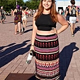 We love how this attendee followed a key rule of crop top dressing: if you're going to bare midriff, offset it with a maxi skirt.