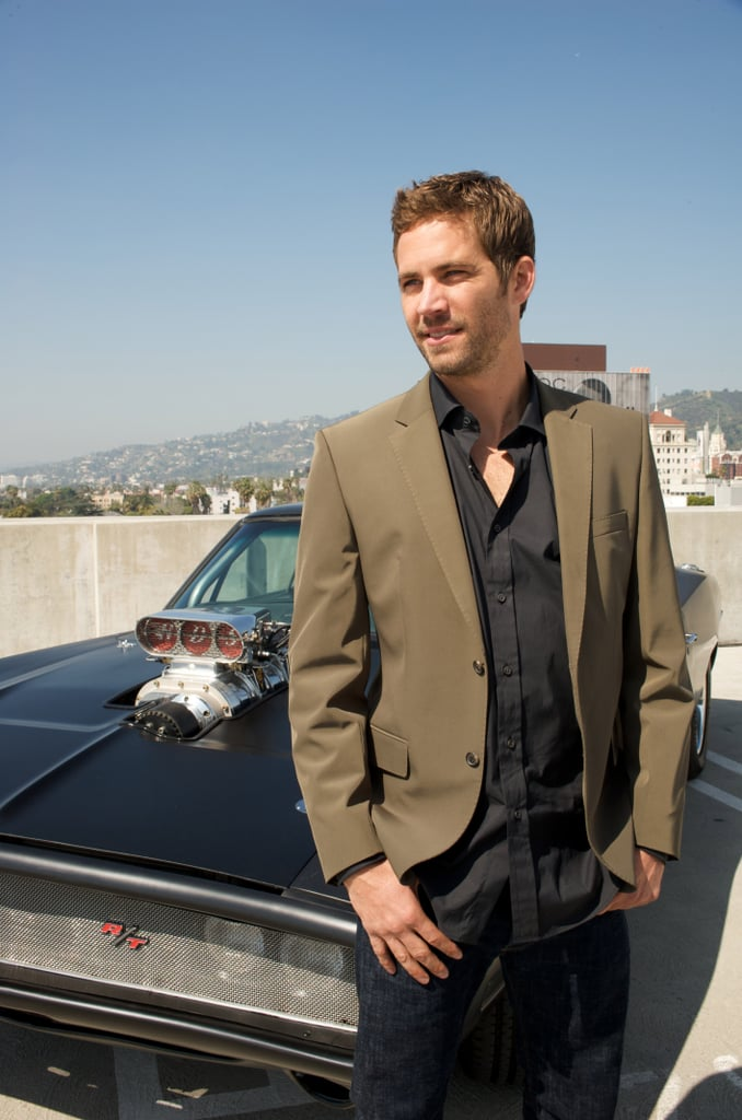 Paul Walker posed with a car at a Hollywood press conference for Fast & Furious in March 2009.