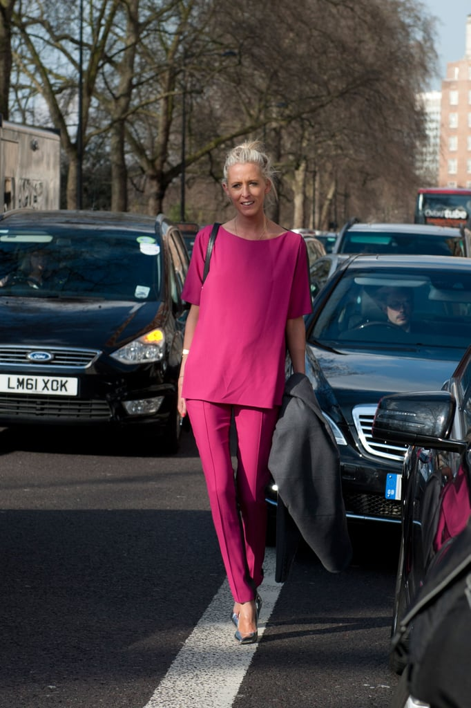This showgoer quite literally stopped traffic in her monochrome fuchsia ensemble.