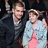 He posed with a young girl at the WWO Host Salon event in NYC in April 2014.