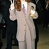 JJulia's iconic grey suit was complete with a purple floral tie at the Golden Globe Awards in 1990.