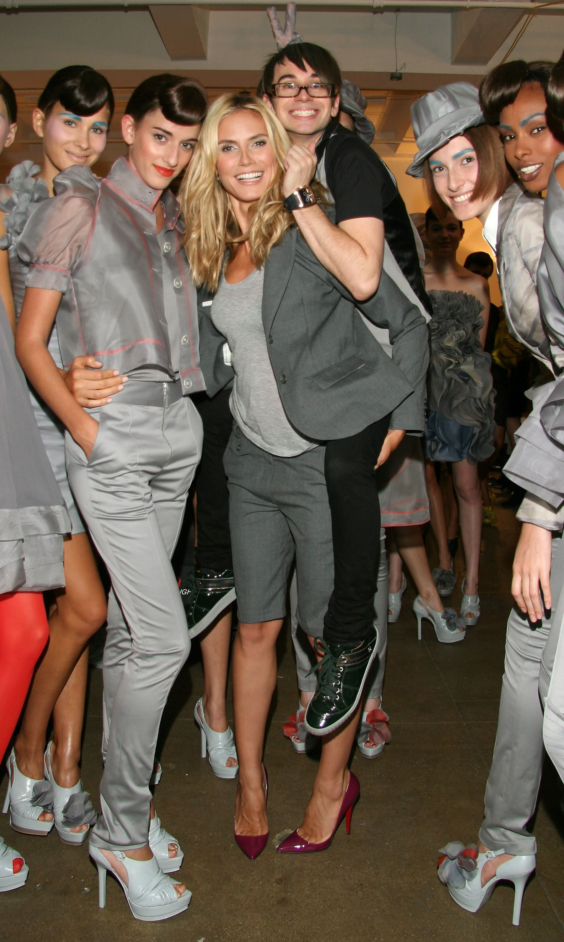 Heidi Klum and designer Christian Siriano posed with models backstage in February 2008.