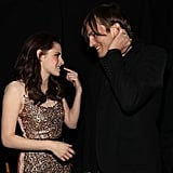 Kristen Stewart and Ashton Kutcher chatted backstage in 2011.