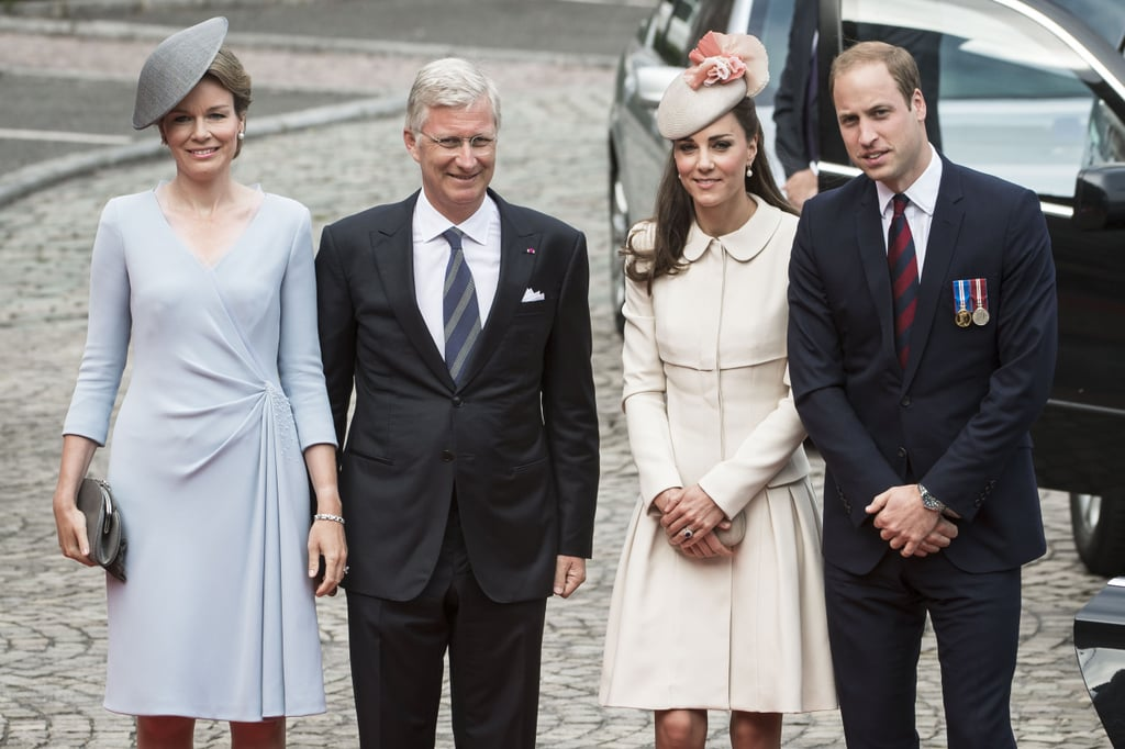 """The Duke and Duchess of Cambridge made a trip to Belgium on Monday to take part in a slew of engagements to honor the 100th anniversary of the beginning of World War I. Kate Middleton and Prince William's first stop was at Le Memorial Interallie in Liege, Belgium, where they were greeted by Belgium's Queen Mathilde (whom Kate curtsied to) and King Philippe and later chatted with French President Francois Hollande. The couple have a busy day in Belgium as they will also attend a lunch and reception at Mons Town Hall and stop by a commemoration event at Saint Symphorien Military Cemetery. William spoke at Le Memorial Inerallie, where he commended the Belgium people's resistance to the German invasion a century ago: """"The people of Belgium's people were gallant and courageously resisted. Your great sacrifice and contribution to eventual victory was critical. Belgium's commitment to honor the war dead continues to this day.""""  The royal family had a busy schedule on Monday to honor the important WWI anniversary. Prince Harry stopped by Kent to lay a poppy wreath and remember the area's soldiers that fought in war. Meanwhile, Prince Charles attended to his duties in Glasgow, where he made a special appearance alongside Prime Minister David Cameron. Although Kate and Will were separated from Harry for this occasion, they will reunite on Tuesday when the young royals will visit the Tower of London's """"Blood Swept Lands and Seas of Red"""" poppy installation in the Tower's moat. The three were all together last week when they got in on the fun of the Commonwealth Games, including photobombing athletes  and Kate showing off her world-famous expressions."""