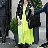 With a splash of citron on a Balenciaga dress, balanced with a sturdy black Givenchy bag in hand.