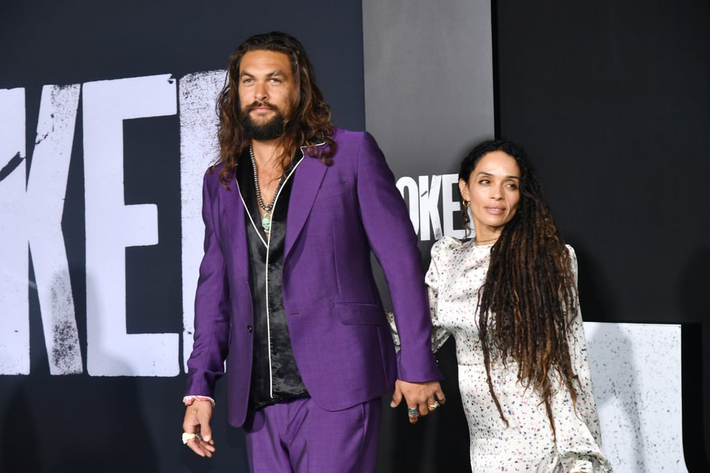 Jason Momoa and Lisa Bonet looked like a million bucks at Joker's LA premiere on Saturday. The adorable duo hit the red carpet dressed to the nines as Jason sported a purple Joker-inspired suit and Lisa rocked a white floral gown with a heart-shaped purse. They walked to the venue hand in hand with Jason looking especially smitten as he gave his wife adorable heart eyes. The actor — who recently delivered a powerful UN speech about climate change — also had a bit of fun striking a few silly poses. Whenever these two hit the red carpet, you can expect some frame-worthy snapshots. Look ahead to view more pictures from their night at the premiere!      Related:                                                                                                           16 Times Jason Momoa and Lisa Bonet's Relationship Was Almost Too Cute to Handle