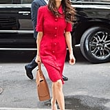Amal wore a red Dolce & Gabbana dress while out in NYC in 2015.