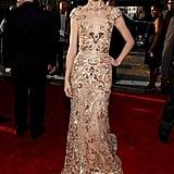 Taylor Swift donned a golden Zuhair Murad gown.