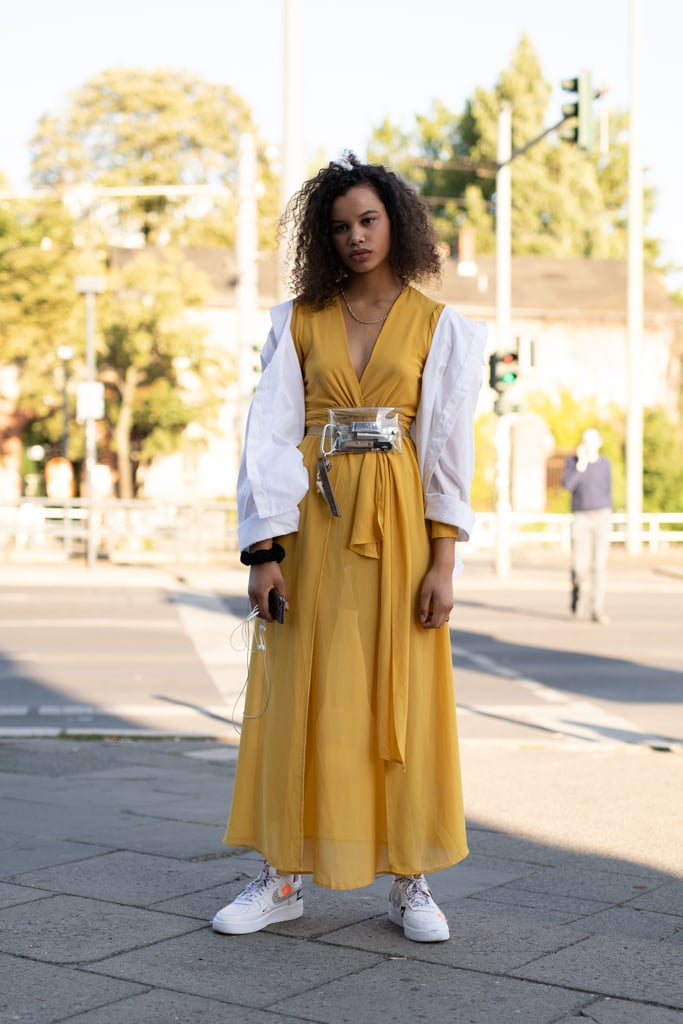 White sneakers are a fresh way to finish off a vibrant maxi dress.