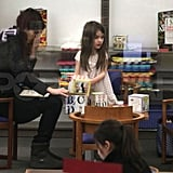 Pictures of Suri Cruise and Tom Cruise at the Vancouver Public Library